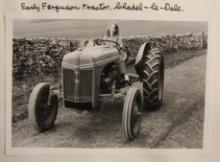 Girl on a tractor - an image from the W.R. Mitchell Archive